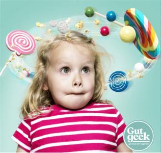 child swirling candies
